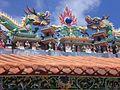 HK Cheung Chau Pak Tei Temple Dragons n Eave n Blue Sky 3.JPG