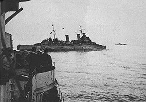 Italian submarine Axum - HMS Nigeria listing after being hit by Axums torpedo