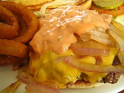 Hamburger topped with grilled onions, cheese and russian dressing.jpg