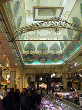 Large, ornate, high-ceilinged delicatessen