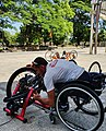 Hassan Dia sets up his handcycle trainer.jpg