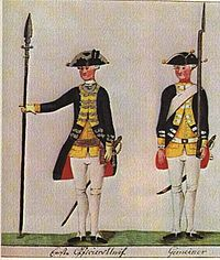 "Portrait of two Hessian auxiliaries deployed in America in their uniforms; one with an upright pike formally at ""dress right"", one with a musket formally at ""left carry arms""."