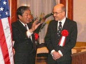 Hirotaka Akamatsu - with James Zumwalt (right)
