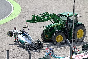 2014 German Grand Prix - Lewis Hamilton's crashed Mercedes F1 W05 Hybrid being hoisted from the gravel at the Sachs Kurve