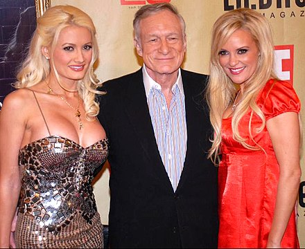 Hefner with his partners Holly Madison (left) and Bridget Marquardt, 2007