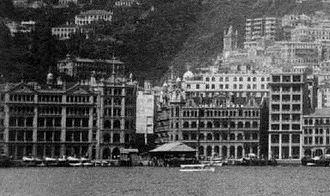 Chater House - View from Victoria Harbour in the 1920s. The building on the left is King's Building, and the adjacent, slightly taller one is Union Building.