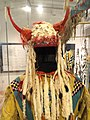 Horned bonnet of weasel skins, worn by Grass Dance leader, Blackfoot, Alberta, c. 1900, with ceremonial shirt, Blackfoot, c. 1880 - Royal Ontario Museum - DSC00325.JPG