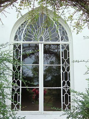 Houghton Lodge - Many of Houghton's windows are in the exaggerated, decorative Gothic, almost Islamic, style which originated from the Walpole's Strawberry Hill Gothic.