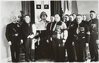 Patriotic People's Movement (Finland) - IKL leadership receiving a bust of Mussolini from an Italian delegation on June 7, 1933. From left: Italian special envoy Gray, Italian ambassador Tamaro, Vilho Annala, Vihtori Kosola, Bruno Salmiala, Juhana Malkamäki, Eino Tuomivaara