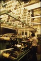 INTERIOR OF THE 3M CO.(MINNESOTA MINING AND MANUFACTURING) PLANT SHOWING AN EMPLOYEE WORKING ON ONE OF THE MACHINES.... - NARA - 558373.tif