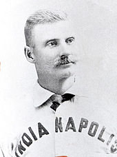 A baseball player is shown in his uniform, from chest up.
