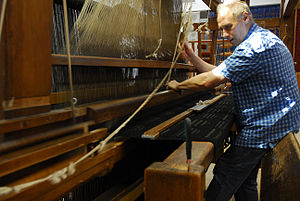 Jacquard loom - Weaving on a jacquard loom with a flying shuttle at the Textile Department of the Strzemiński Academy of Fine Arts in Łódź, Poland.