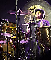 A colour photograph of Jason Bonham playing drums