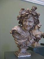 Jean-Baptiste Carpeaux-Lauphing boy with vine leaves in his hair-Ny Carlsberg Glyptotek.jpg
