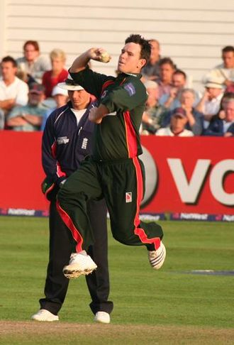 Bowling (cricket) - Jim Allenby in midflight, illustrating the position of the body during a delivery at the end of a run up, prior to bowling the ball.