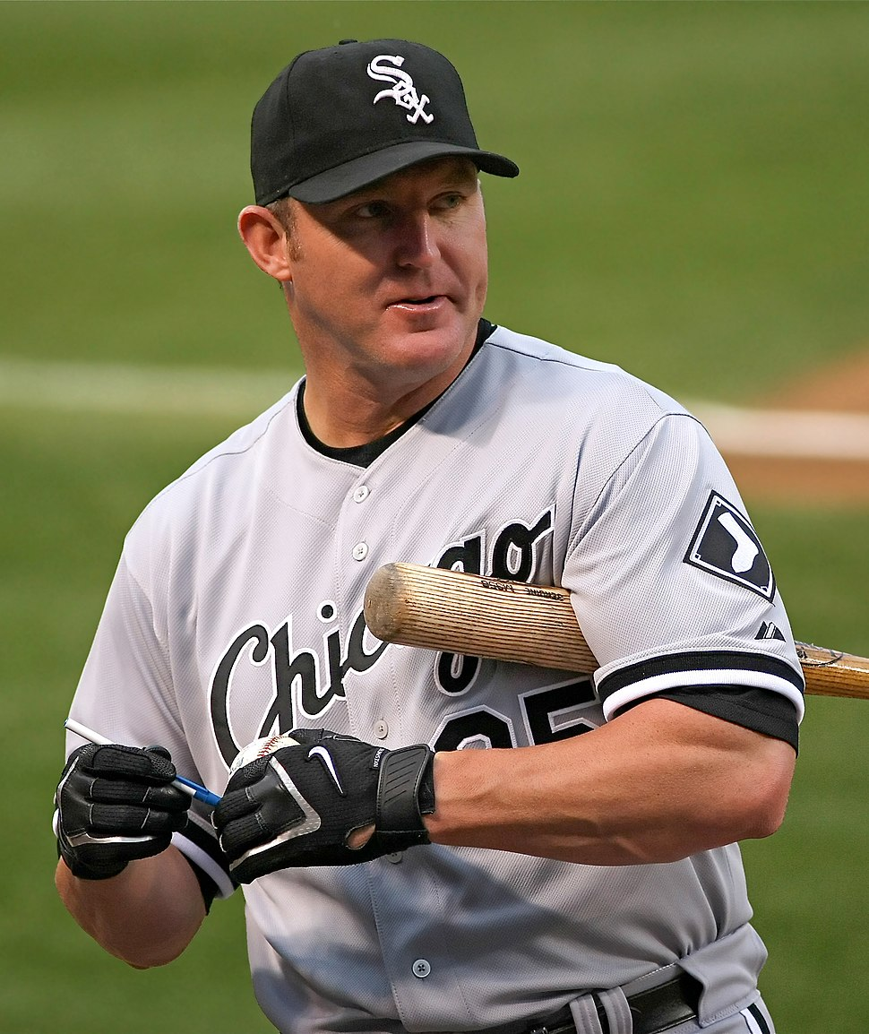 Thome signing an autograph as a member of the White Sox; he is holding his bat under his left shoulder.