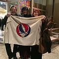 John Perry Barlow, Nicki Scully, and Jerilyn Lee Brandelius at Rock Scully Memorial with vintage Stealie Flag.JPG