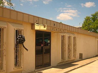 Julio A. Garcia - A black ribbon marks the passing of Julio A. Garcia at his former law office at 2602 Arkansas Street in Laredo, Texas. The building was since closed and razed.