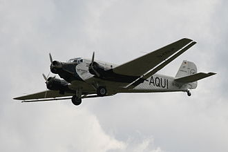 "Junkers Ju 52 - Lufthansa's 21st-century airworthy heritage Ju 52/3mg2e (Wk-Nr 5489) in flight, showing the Doppelflügel, ""double wing"" trailing edge control surfaces."