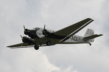 "Lufthansa's 21st-century airworthy heritage Ju 52/3mg2e (Wk-Nr 5489) in flight, showing the Doppelflugel, ""double wing"" trailing-edge control surfaces Junkers Ju 52-3mg2.jpg"