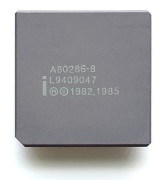 Intel 80286 - An Intel A80286-8 processor with a gray ceramic heat spreader.