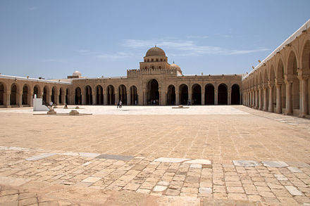The Great Mosque of Kairouan also known as the Mosque of Uqba was established in 670 by the Arab general and conqueror Uqba ibn Nafi, it is the oldest mosque in the Maghreb, situated in the city of Kairouan, Tunisia. Kairouan's Great Mosque courtyard.jpg