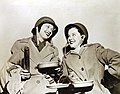 Kay Francis and Mitzi Mayfair pose in their traveling costumes after USO Camp Show overseas (34244884953).jpg