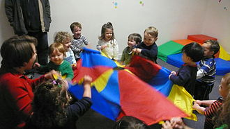 Day care - Children play under the supervision of a daycare staffer.