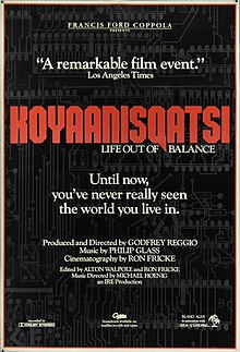 "A black film poster with a dark gray pattern like a microchip, reading in small print at the top ""FRANCIS FORD COPPOLA PRESENTS"" with ""KOYAANISQATSI"" in large red text, subtitled below with ""LIFE OUT OF BALANCE"" The white text in the middle reads ""Until now, you've never really seen the world you live in."" Below that text, reads ""DIRECTED BY Godfrey Reggio, MUSIC BY Philip Glass, CINEMATOGRAPHY BY Ron Fricke"". Various further credits and logos are at the bottom of the poster."