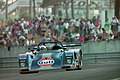 Kremer K8 - Derek Bell, Jurgen Lassig & Robin Donovan exits the Esses at the 1994 Le Mans (31933400076).jpg