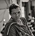 Lady at the Market (11842950475).jpg