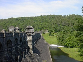 Lake Vyrnwy - The dam looking east, showing compensation water being released from the reservoir