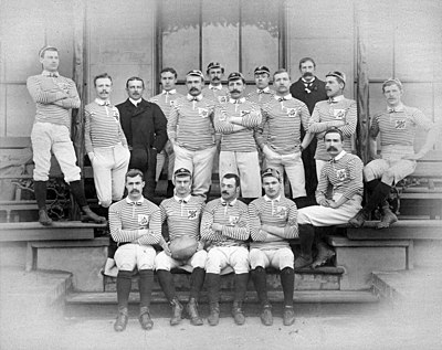 A body or rugby union players posing in uniform before a match
