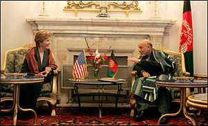 Afghan President Hamid Karzai jokes with Laura...