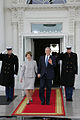 Laura and George Bush walking out Entrance Hall.jpg