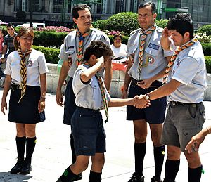 Scout leader - Leaders welcome a boy into Scouting, March 2010, Mexico City, Mexico.