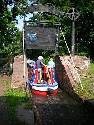 Kings Norton - Lifford Lane guillotine stop lock, comprising two similar gates either side of the road bridge.