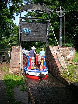 Kings Norton - Lifford Lane guillotine stop lock, comprising two similar gates either side of the road bridge.