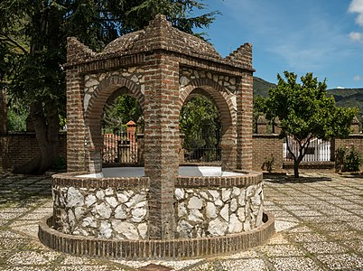 Fountain on the church place of Linares de la Sierra, Andalusia, Spain