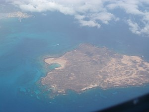 Lobos Island - Aerial view of Lobos Island, with the harbour of Corralejo, Fuerteventura Island, in the top left corner