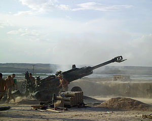 Canada's role in the War in Afghanistan - Canadian soldiers fire an M777 155mm Howitzer field artillery gun at Taliban fighting positions near the Sangin District Center.