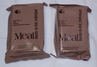 Meal, Ready-to-Eat - Two MRE packets: beef teriyaki and meatloaf with gravy