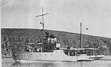 a black and white image of a ship underway