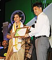 Manish Tewari presenting the Limca Book of Record 'People of the Year'2013 to Film Actress, Shabana Azmi, at a function, in New Delhi on April 10, 2013.jpg