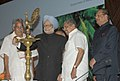Manmohan Singh lighting the lamp to inaugurate the 11th Pravasi Bharatiya Divas, in Kochi. The Chief Guest and President of the Republic of Mauritius, Mr. Rajkeswur Purryag, the Union Minister for Overseas Indian Affairs.jpg