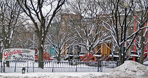 Mansion Historic District - Mansion Neighborhood Christmas sign in Bleecker Park, with Madison Place in background