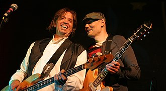Billy Corgan - Corgan (right) performing with Mark Tulin of The Electric Prunes at a benefit concert for Sky Saxon