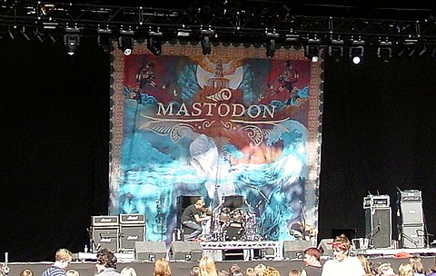 A Mastodon backdrop in 2006, showcasing an elaborate painting, using the Leviathan artwork by the painter Paul Romano Mastodon live 2006.jpg