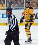 Matt Hunwick and referee during 2010 Winter Classic.jpg