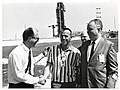 Mayor John F. Collins with Alan Shepard and two unidentified men at Air Force Eastern Test Range, Cape Kennedy (now Cape Canaveral) (10158930213).jpg